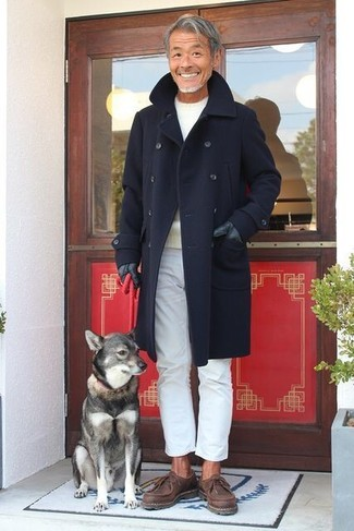 How to wear: navy overcoat, beige crew-neck sweater, white chinos, dark brown leather desert boots