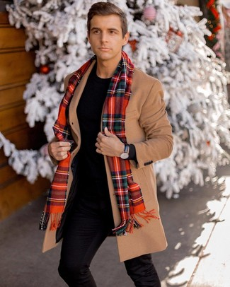 How to wear: camel overcoat, black crew-neck sweater, black chinos, red plaid scarf