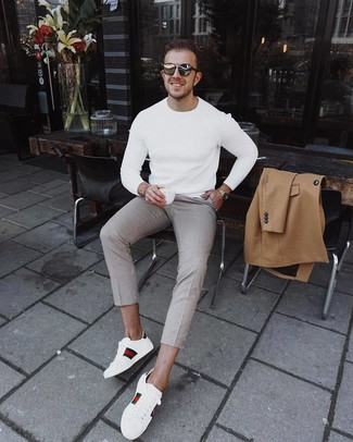 How to wear: camel overcoat, white crew-neck sweater, beige check chinos, white print leather low top sneakers