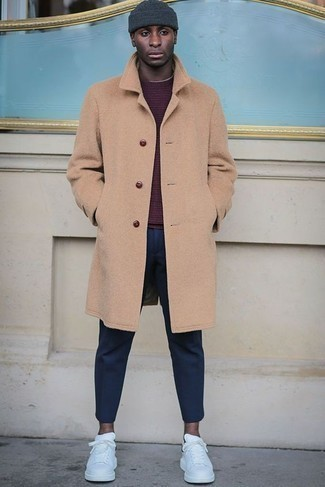 How to Wear Sneakers For Men: You'll be amazed at how easy it is for any guy to pull together this casually smart look. Just a camel overcoat worn with navy chinos. For something more on the daring side to complete this outfit, add sneakers to the equation.