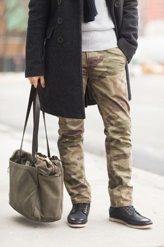How to Wear an Olive Canvas Tote Bag For Men: For relaxed dressing with an edgy spin, you can easily wear a charcoal overcoat and an olive canvas tote bag. And it's amazing what black leather casual boots can do for the look.