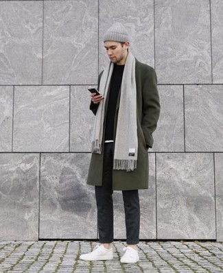 Charcoal Chinos Cold Weather Outfits: So as you can see, looking dapper doesn't take that much work. Try teaming an olive overcoat with charcoal chinos and you'll look awesome. White canvas low top sneakers will bring a laid-back touch to an otherwise traditional outfit.