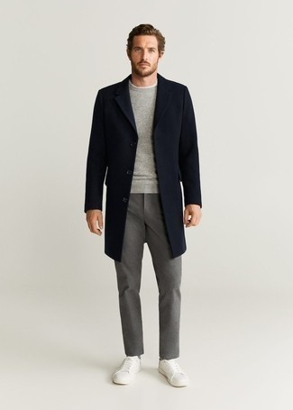 Navy Overcoat Outfits: Make a navy overcoat and grey chinos your outfit choice for effortless sophistication with a masculine twist. White canvas low top sneakers are an effective way to add a confident kick to the outfit.