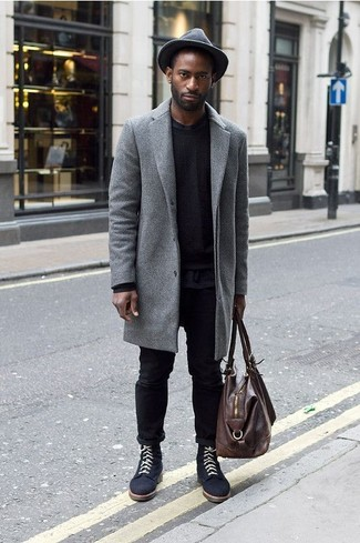How to Wear a Brown Leather Holdall In Your 30s In Chill Weather For Men: This pairing of a grey overcoat and a brown leather holdall is on the casual side yet it's also sharp and truly dapper. A pair of navy suede casual boots easily dials up the style factor of any look.
