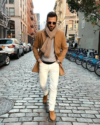 How to wear: camel overcoat, grey crew-neck sweater, black crew-neck t-shirt, white skinny jeans