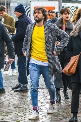 How to Wear a Yellow Crew-neck Sweater For Men: This is hard proof that a yellow crew-neck sweater and blue ripped jeans look awesome when paired together in a city casual look. A pair of white leather low top sneakers easily turns up the fashion factor of your ensemble.