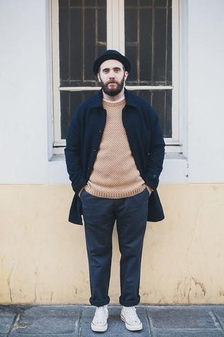 How to Wear a Bucket Hat For Men: If you're a jeans-and-a-tee kind of guy, you'll like this straightforward but cool and relaxed combination of a navy overcoat and a bucket hat. This ensemble is completed perfectly with a pair of white canvas high top sneakers.