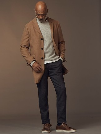 How to Wear a Camel Overcoat: For a winning smart casual option, you can never go wrong with this combination of a camel overcoat and charcoal chinos. Don't know how to finish off? Introduce brown leather low top sneakers to your outfit to jazz things up.