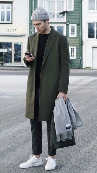 How to wear: olive overcoat, black crew-neck sweater, black dress pants, white leather low top sneakers