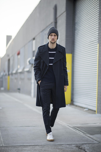 How to Wear a Black Overcoat: Marrying a black overcoat and black check dress pants is a fail-safe way to infuse an elegant touch into your current styling rotation. Does this getup feel too classic? Introduce a pair of white leather low top sneakers to switch things up.