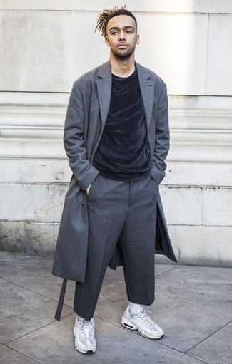 How to Wear Charcoal Wool Dress Pants For Men: A charcoal overcoat and charcoal wool dress pants are robust sartorial weapons in any modern man's sartorial arsenal. For a more relaxed take, why not complete this outfit with a pair of white athletic shoes?