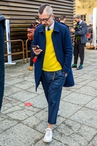 Men's Looks & Outfits: What To Wear In 2020: This combo of a navy overcoat and navy wool chinos is the perfect base for an outfit. On the fence about how to finish? Complement your getup with white leather low top sneakers for a more laid-back spin.