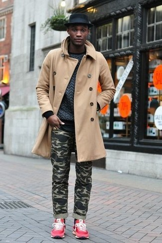 How to wear: camel overcoat, charcoal quilted crew-neck sweater, olive camouflage jeans, red suede low top sneakers