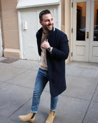 How to wear: navy overcoat, tan knit crew-neck sweater, blue jeans, beige suede chelsea boots