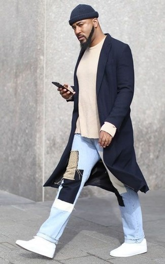How to Wear a Beige Crew-neck Sweater For Men: Go for a pared down but at the same time casually stylish option by marrying a beige crew-neck sweater and light blue patchwork jeans. The whole outfit comes together perfectly when you complete this getup with a pair of white canvas low top sneakers.