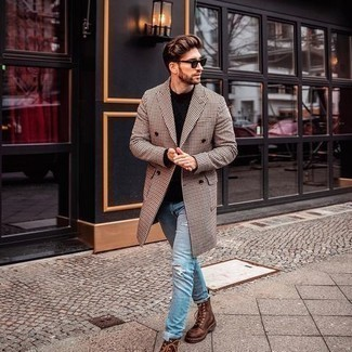 Black Crew-neck Sweater Outfits For Men: If you're a jeans-and-a-tee kind of guy, you'll like this basic but laid-back and cool combo of a black crew-neck sweater and light blue ripped jeans. Got bored with this outfit? Invite brown leather casual boots to shake things up.