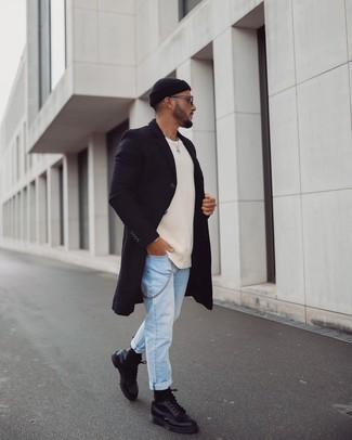 Beige Crew-neck Sweater Outfits For Men: This combo of a beige crew-neck sweater and light blue jeans is irrefutable proof that a safe casual look doesn't have to be boring. A pair of black leather casual boots effortlessly steps up the fashion factor of any outfit.