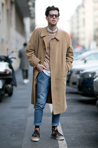 How to wear: camel overcoat, tan crew-neck sweater, white long sleeve shirt, blue jeans