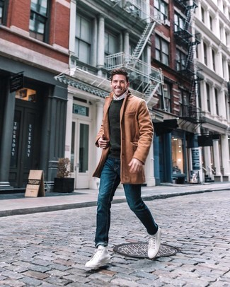 How to wear: camel overcoat, charcoal crew-neck sweater, white long sleeve shirt, blue jeans