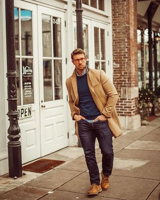 How to wear: camel overcoat, navy crew-neck sweater, white and navy vertical striped long sleeve shirt, navy jeans