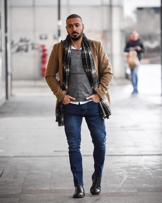 How to wear: camel overcoat, grey crew-neck sweater, white long sleeve shirt, navy jeans