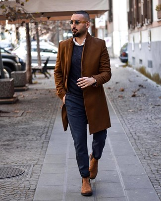 How to Wear a Brown Overcoat: Swing into something effortlessly neat and current with a brown overcoat and navy chinos. Throw in a pair of brown suede chelsea boots to instantly change up the outfit.