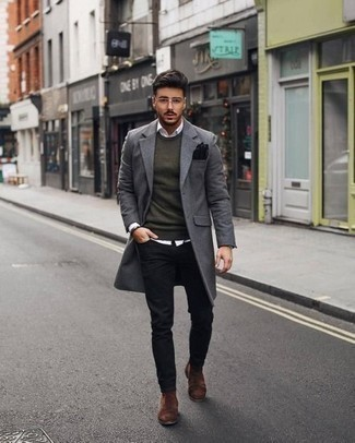 How to Wear Black Jeans For Men: Show that no-one does semi-casual menswear quite like you do by wearing a grey overcoat and black jeans. Bump up this getup by sporting brown suede chelsea boots.