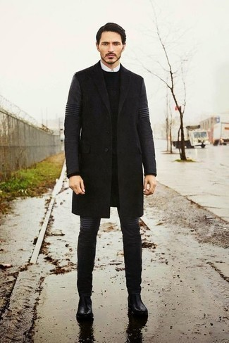 How to Wear a Black Crew-neck Sweater For Men: A black crew-neck sweater and charcoal jeans are the ideal way to inject muted dapperness into your day-to-day repertoire. Tone down the casualness of this outfit with a pair of black leather chelsea boots.