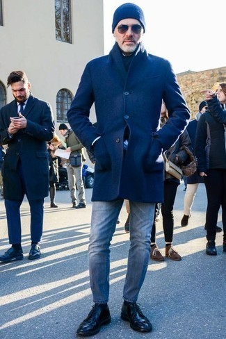 How To Wear an Overcoat With Jeans: This combo of an overcoat and jeans is a surefire option when you need to look casually classic in a flash. If you wish to immediately amp up this getup with a pair of shoes, why not add a pair of black leather derby shoes to the mix?