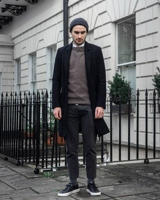 How to Wear a Black Overcoat: Consider pairing a black overcoat with charcoal chinos for laid-back elegance with a manly finish. You can get a little creative on the shoe front and complete this outfit with a pair of black leather low top sneakers.