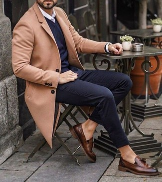 Gold Bracelet Outfits For Men: For a laid-back look with an urban spin, you can always rely on a camel overcoat and a gold bracelet. And if you want to effortlessly lift up your getup with one piece, why not add a pair of brown leather tassel loafers to the equation?