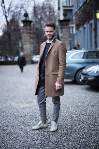 1200+ Smart Casual Outfits For Men: Pairing a camel overcoat with grey chinos is an awesome idea for an effortlessly sleek ensemble. For something more on the daring side to round off this ensemble, complete your look with white leather low top sneakers.