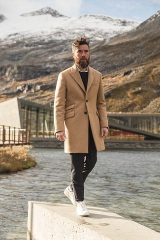 Sweater Outfits For Men: A sweater and dark brown chinos are a cool getup to add to your casual fashion mix. White canvas low top sneakers will infuse a dose of polish into an otherwise straightforward ensemble.