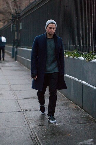 How to wear: navy overcoat, dark green crew-neck sweater, black skinny jeans, black leather slip-on sneakers