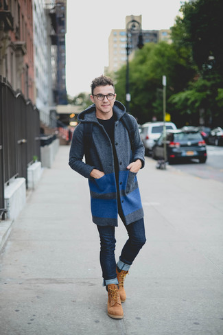 How to wear: charcoal overcoat, black crew-neck sweater, navy skinny jeans, tan suede work boots