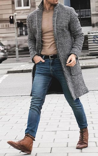 How to wear: grey houndstooth overcoat, tan crew-neck sweater, blue skinny jeans, brown leather casual boots