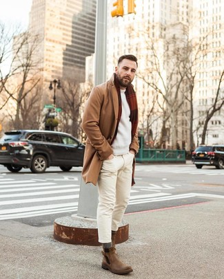 How to Wear Beige Skinny Jeans For Men: Pair a camel overcoat with beige skinny jeans to don a casually stylish ensemble. Brown leather chelsea boots will add a more elegant twist to your ensemble.