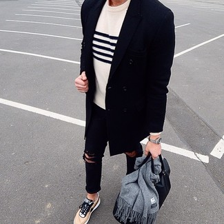 How to wear: navy overcoat, white and navy horizontal striped crew-neck sweater, black ripped skinny jeans, tan low top sneakers