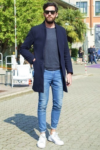 How to Wear a Navy Overcoat: A navy overcoat and blue skinny jeans will inject your day-to-day styling arsenal this casually cool vibe. For a more casual spin, complement your outfit with a pair of white low top sneakers.