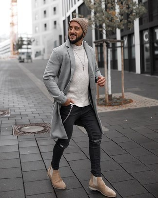 Beige Crew-neck Sweater Outfits For Men: A beige crew-neck sweater and black ripped skinny jeans teamed together are a good match. If you feel like stepping it up, grab a pair of tan suede chelsea boots.