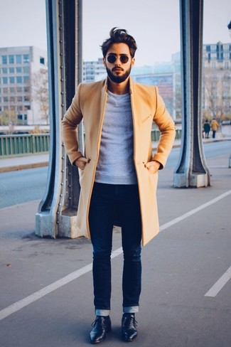 This look with a coat and navy slim jeans isn't a hard one to achieve and open to more creative experimentation. Black leather derby shoes will instantly elevate even the laziest of looks. An outfit like this makes it easy to embrace unpredictable transitional weather.