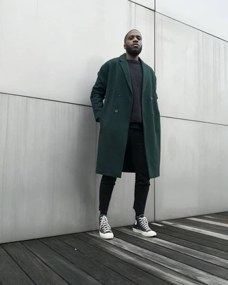 Black Skinny Jeans Outfits For Men: This off-duty pairing of a dark green overcoat and black skinny jeans is a life saver when you need to look dapper but have no time. To inject a touch of stylish effortlessness into your ensemble, add a pair of black print canvas high top sneakers to this ensemble.