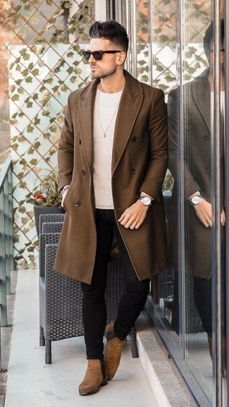 Black Skinny Jeans Outfits For Men: This ensemble with a brown overcoat and black skinny jeans isn't super hard to score and is easy to change. If you wish to easily up the ante of your ensemble with footwear, why not complement this outfit with a pair of brown suede chelsea boots?