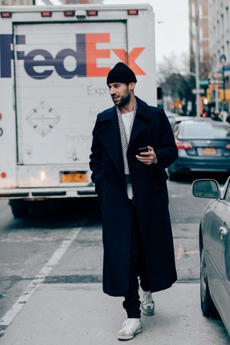 How to wear: navy overcoat, white crew-neck sweater, black sweatpants, white leather low top sneakers