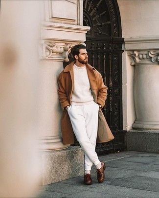Beige Crew-neck Sweater Outfits For Men: Wear a beige crew-neck sweater and white sweatpants for comfort dressing with a contemporary spin. You could perhaps get a bit experimental with footwear and polish up this ensemble by sporting brown leather desert boots.