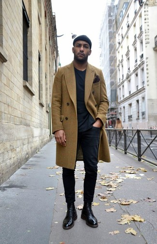 How to wear: olive overcoat, black crew-neck t-shirt, black chinos, black leather dress boots