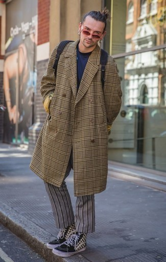 How to Wear a Brown Plaid Overcoat: Showcase that no-one does smart casual menswear like you in a brown plaid overcoat and grey vertical striped chinos. Feeling transgressive today? Shake things up by sporting black and white check canvas high top sneakers.