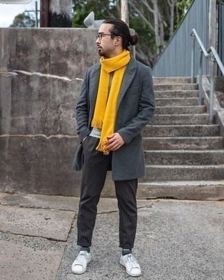 How to Wear a Grey Overcoat: This outfit with a grey overcoat and black vertical striped chinos isn't hard to pull off and is open to more sartorial experimentation. To infuse a bit more edginess into your getup, add a pair of white canvas low top sneakers to the equation.
