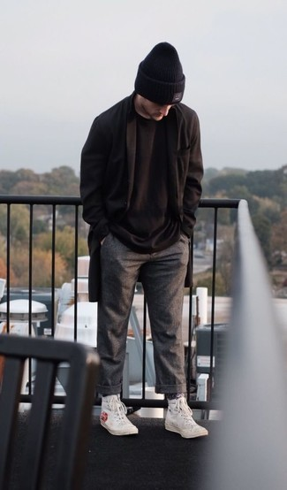 Black Beanie Outfits For Men: A black overcoat and a black beanie are must-have menswear pieces, without which our menswear arsenals would feel incomplete. All you need is a nice pair of white print canvas high top sneakers to complement your ensemble.