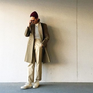 Beanie Outfits For Men: No matter where the day takes you, you can always rely on this casual combo of an olive overcoat and a beanie. The whole ensemble comes together if you make beige canvas high top sneakers your footwear choice.